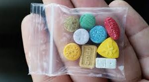 white, grey, red, brown, yellow and blue Ecstasy pills